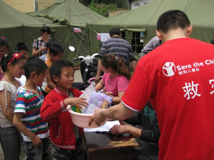 Children line up to receive relief supplies from Save the Children in the aftermath of the Ya'an earthquake that struck Sichuan province in April 2013.